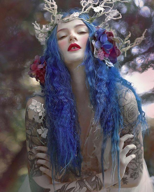 @bluexastrid modelin costume from @fireflypath  in my fantasy dimension ✨ #agnieszkalorek #fantasy #fairy #fairytale #elf #elves #creature #blue #bluehair #headpiece #shoot #flowers #instacool #instalove #fineart #unreal #nymphs #costume #dress #lovely #girl #model #tattoo #longhair