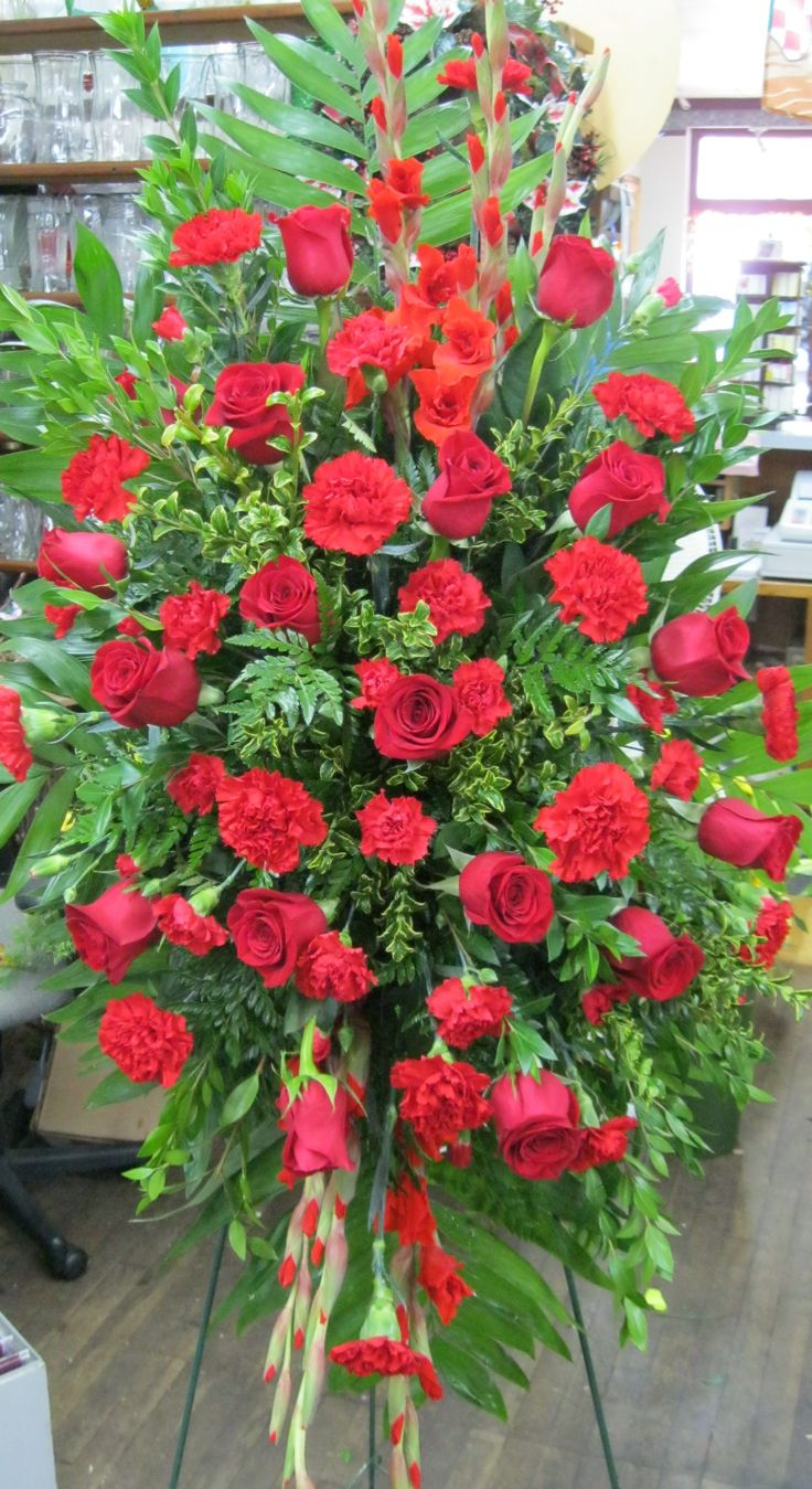 70 best funeral easels images on pinterest flower arrangements a beautiful standing easel spray in all reds roses carnations and red gladiola express izmirmasajfo