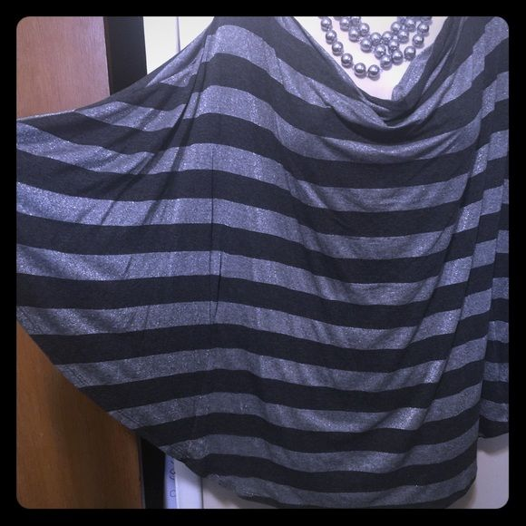 WHBM Silver and black batwing top! I bought this and never wore it. It's super cute black with grey blingy stripes. It is batwing sleeves but the middle is more fitted. 100% poly. White House Black Market Tops Tunics