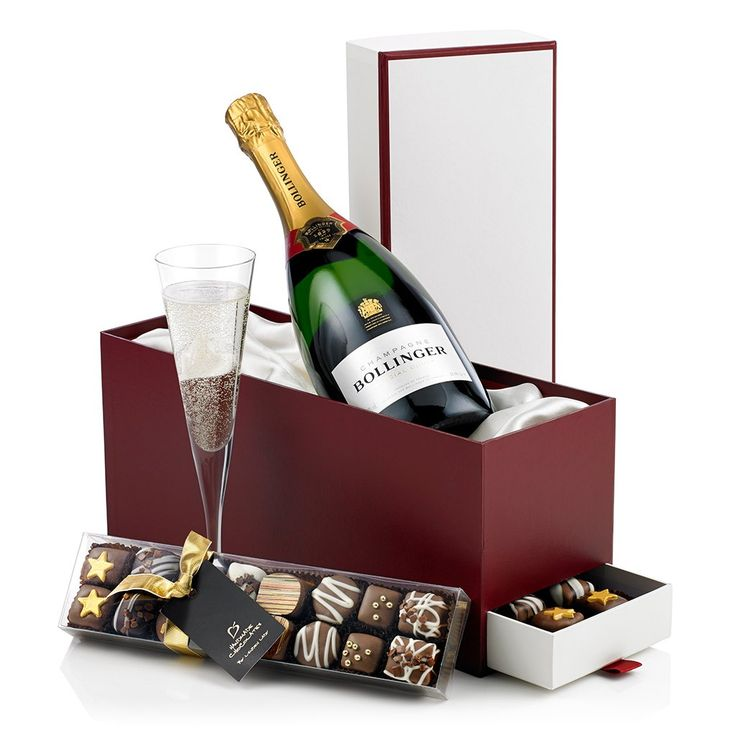 Bollinger & Chocolates | This classic bottle of Bollinger is beautifully presented on a bed of white satin and encased in a sleek burgundy and white presentation box.