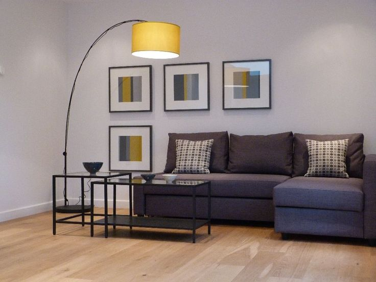 Small Living Room Present Yellow Drum Arch Floor Lamp Over Gray Friheten Sofa