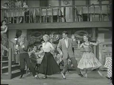 "Bob Fosse, Debbie Reynolds, Bobbby Van and Barbara Ruick Dance and Sing in movie, ""The Affairs of Dobie Gillis (1953).  Fosse is in the sweater with the light socks.  He might not have choreographed this number, but the man can dance!"