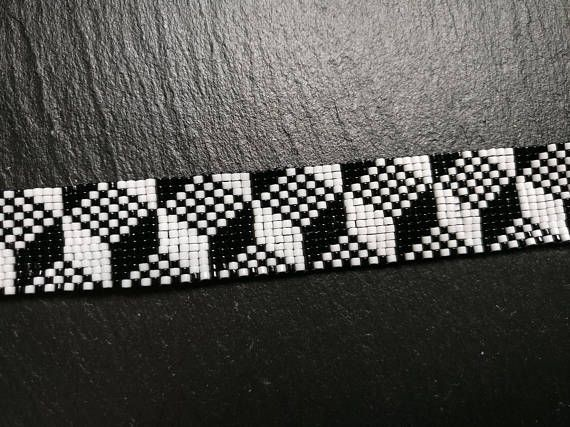 Hand woven Miyuki seed bead pixel bracelet in black and white. Made with 11/0 Miyuki seed beads. Length: 15,5 cm (6.10) with a 5 cm (1.96) extension. Width: 2 cm (0.79)