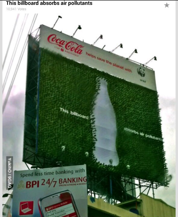 "Billboard with a green plant...good company ""coke"""