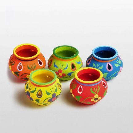 Rich & vibrant - decorative light holders. http://www.fabfurnish.com/Cultural-Concepts-Matki-T-Light-Holder-5-Pcs-186641.html