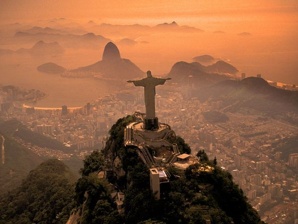 Christ the Redeemer    Located in Rio De Janeiro, Brazil     Stands 38 meters high at the summit of the Corcovado mountain looking over the city designed by a French sculptor (Paul Landowski and engineer (Heitor de Silva Costa)
