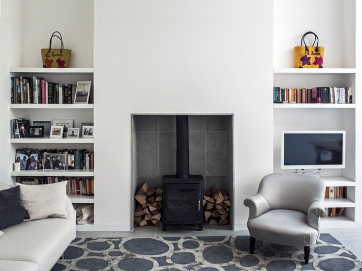 Living room interior design.  Wood burner fireplace shelving, contemporary living room. Charles Barclay Architects