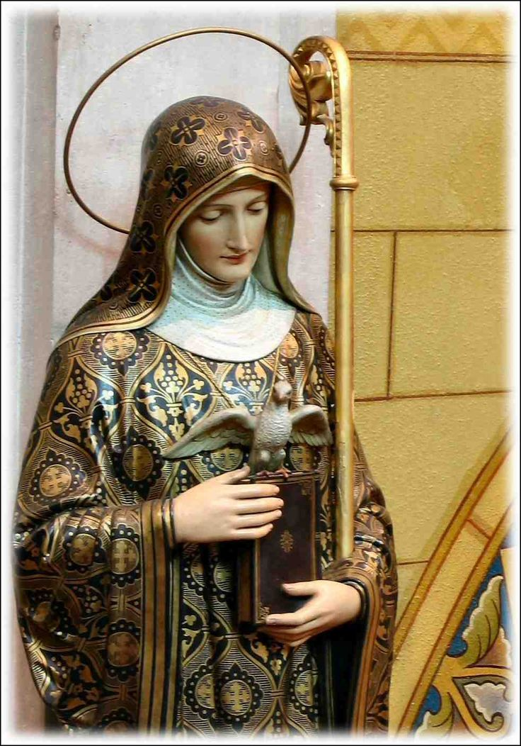St. Scholastica was the sister of St. Benedict and founded a monastery is Plombariola, Italy near her brother's Monte Cassino. Upon her death, according to legend, St. Benedict envisioned her soul departing her body and ascending into heaven in the form of a dove.  From http://www.clydemonastery.org/StoneStories/?p=1273