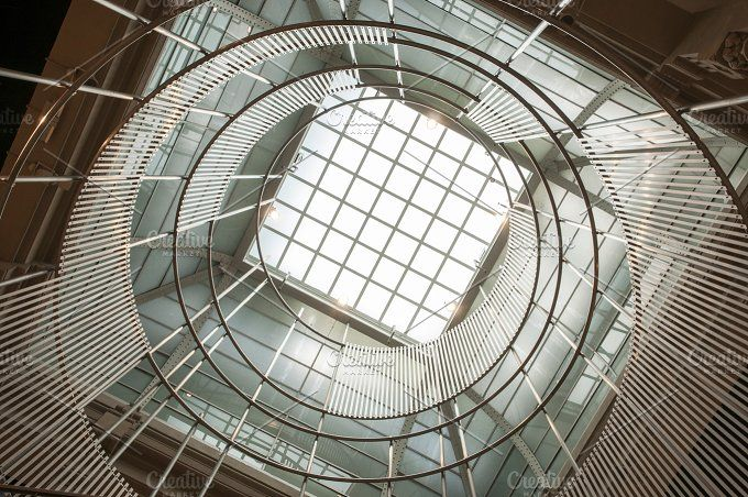 architecture with round window by Arnaufoto on @creativemarket