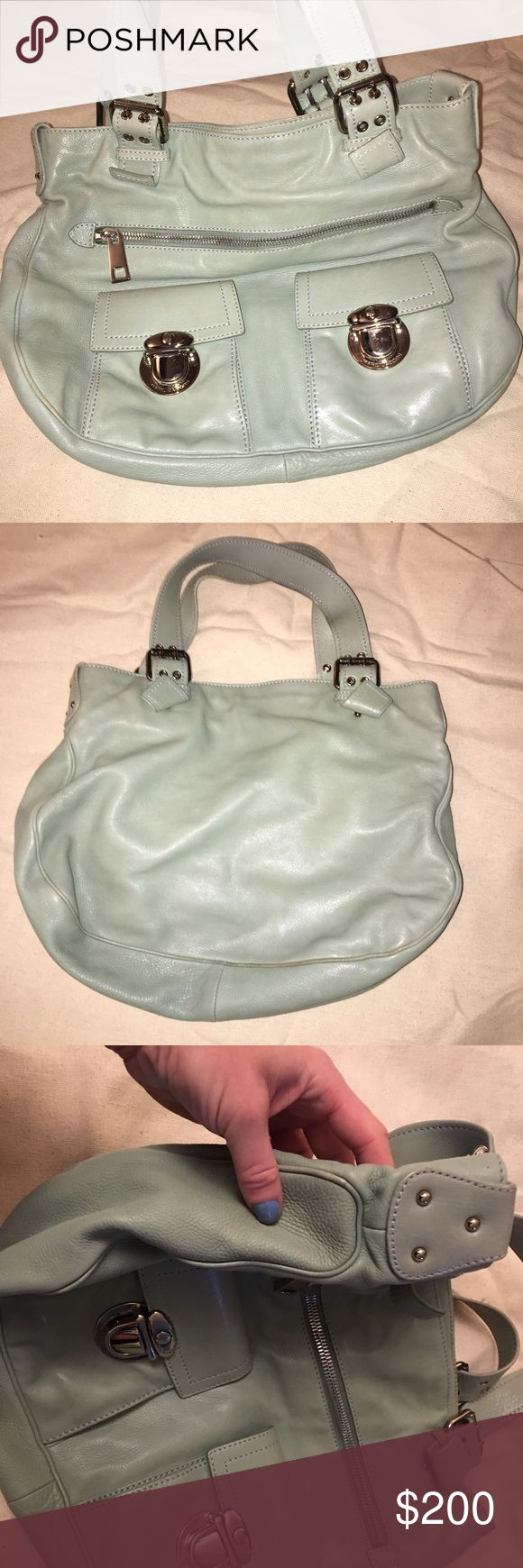 Gorgeous mint green Marc Jacobs Shoulder Bag EUC Marc Jacobs leather shoulder bag in GREAT condition. A few light marks on interior (see photo) and minor wear on seam on bottom (see photo) but hardly noticeable. This is a great bag for work or play- it holds a TON! Marc Jacobs Bags Shoulder Bags