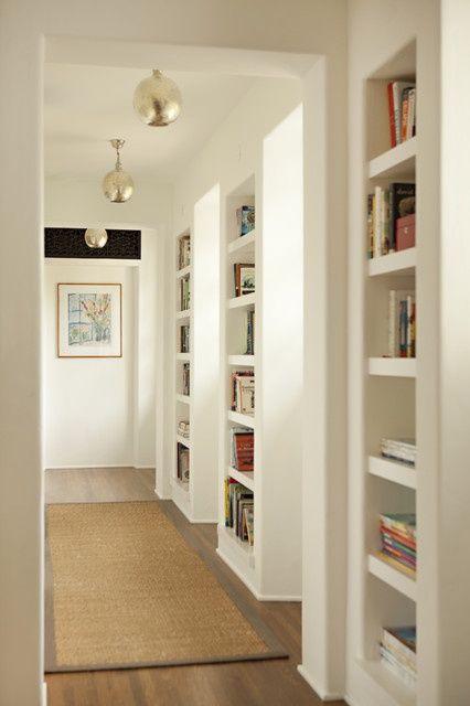 ** Shelves between studs in hallway to make hall look wider