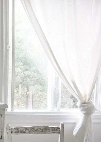 have white curtains that float in the ocean breeze