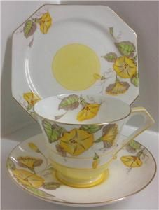 Paragon China - yellow convolvulus ? pattern - gold rim, yellow foot & handle stripe - vintage art deco tea cup trio - ex ebay.co.uk