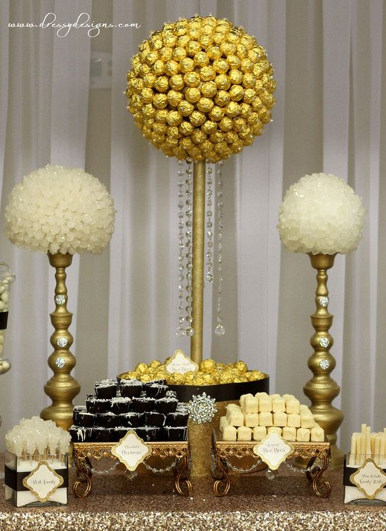 A Great ImageGold and ivory candy/dessert buffet, bon bons, rock candy, gold sequin table linen