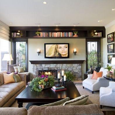 cozy, classy livingroom  Like the estantería de encima.  Like la combinación estante mesa oscuros