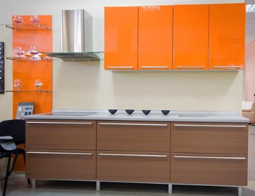 Paint the kitchenette cabinets a crazy bright color? #orange