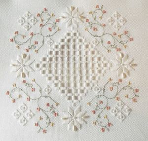"© Polstitches Designs  ""A hardanger designs with full teaching instructions stitched on the Antique White Fabric with a splash of beads, pearls and Gast Hand Dyed Threads for an elegant effect. The design can be used as a cushion, table centre and also makes a wonderful ring pillow  Stitched Area 82w X 82h Stitches Design Area 5.86 x 5.86 Inches  Designed by Polstitches Designs  Kit does contains everything to complete the design.  Chart only £8.99, Kit £28.00"""