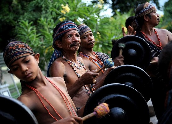 Maumerenese men play traditional music during a dance on Flores island in East Nusa Tenggara, Indonesia. Photo: AFP