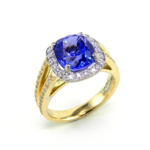 Cushion cut natural fine Tanzanite, 3.33ct, set in 18 carat gold, with a diamond halo surround. Ring by Anania Jewellers, Sydney. #Gemstones #Tanzanite #handcrafted