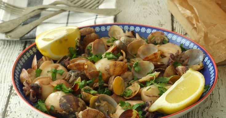 Choquinhos e ameijoas num molho de vinho branco, coentros e limão. Small cuttlefish and clams in a white wine, coriander and lemon sauce.
