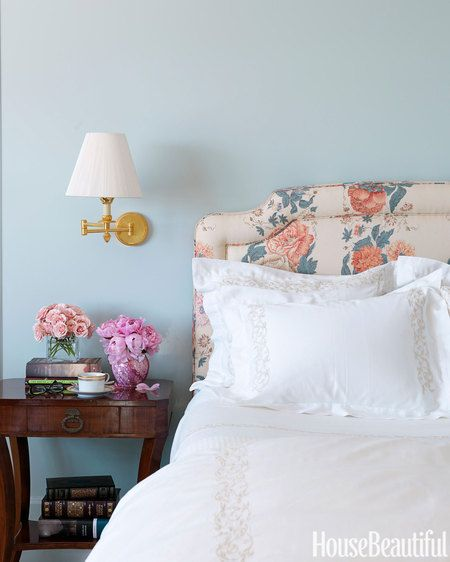 The color — Benjamin Moore's Harbor Haze — also freshens up a very traditional floral headboard.