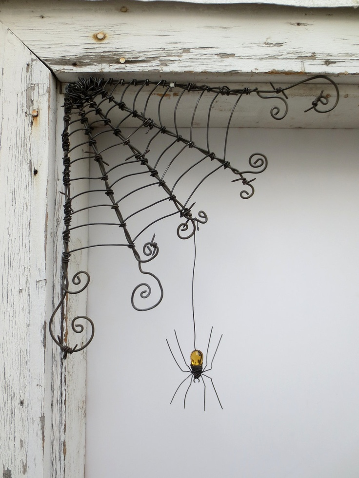 "Czechoslovakian Yellow Spider Dangles From 12"" Barbed Wire Corner Spider Web. $51.00, via Etsy. This could be another DIY project!"