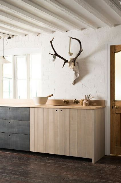 Clean lines and a simple design, but the ladle and cup hanging from the antlers add a whimsical touch.