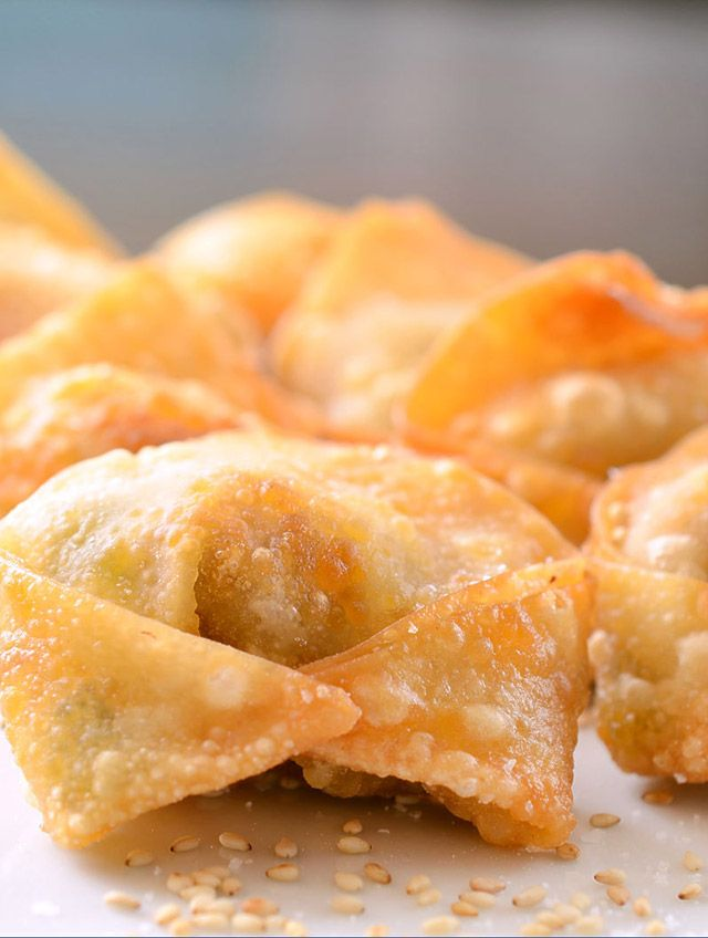 Succulent and spicy sriracha pulled pork wrapped in a crispy wonton shell. It's the stuff dreams are made of.