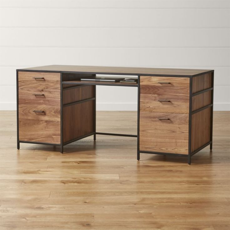A versatile mix of open and closed storage, the Knox desk sets solid walnut in an architectural iron frame for a clean-lined look that works anywhere. The wood's gorgeous grain is brought to the fore by a hand finish by skilled craftsmen. The Knox Executive Desk is a Crate and Barrel exclusive.