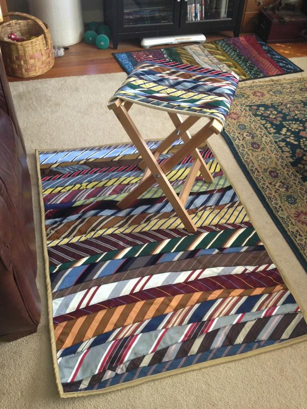 """12 Ways to Upcycle Old Neckties: This winning combination was created by blogger and professional seamstress Alison Tudor of SewandTellQuilts.com. """"I first got interested in making things out of old ties after I inherited 198 of them from my great aunt,"""" Tudor says. She uses a thick felt backing for her necktie rugs because it's easy to sew and adds a cushion. She also makes the folding camp stool herself using materials from a big-box store, including an inexpensive painter&r…"""