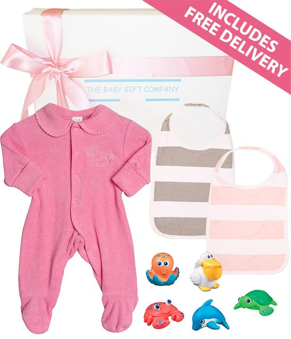 A beautiful baby girl gift basket Containing a comfy all-in-one long sleeve baby bodysuit, two cotton baby bibs and a set of 5 fun bath time water squirter toys.