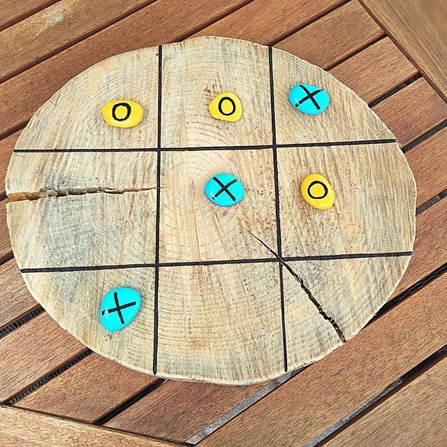 Just made a Tic-Tac-Toe board from a tree trunk slice and painted rocks- Summer Backyard Games. #lovesoulshine #games #diy #tictactoe #diycrafts #familyfun #summerbbq #fun #recycle #repurpose