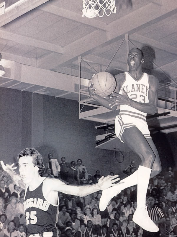 Michael Jordan in high school. The dorky white guy getting dunked on--I had him for AP European history at Laney in HS. Too funny!
