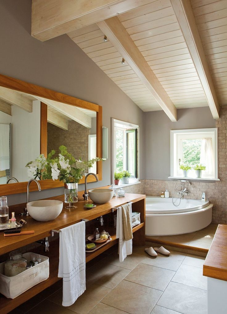 Small attic bathroom with exposed beams and tongue and grove ceilings.