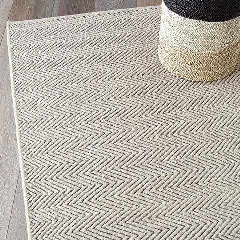 Herringbone Weave Rug - Subtle, meandering stripes give an understated elegance to add a classically stylish signature to any space. The look brings masculinity yet warmth and depth. Wool/Cotton Blend.  Fair Trade hand woven wool rug crafted by Artisans in India. This product is made from natural, sustainable fibres and will fade in natural sunlight. Please note that some color may transfer on light colored surfaces. Rotate your rug to minimize damage caused by natural light.