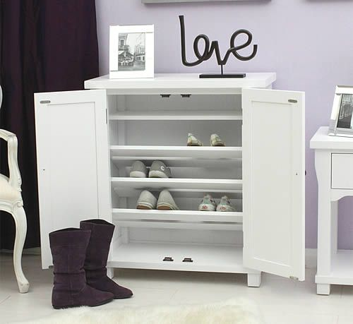 White Wood Shoe Storage Cabinet - Hampton at STORE. White finished solid ash shoe storage cabinet that can store up to 14 pairs of shoes. ...