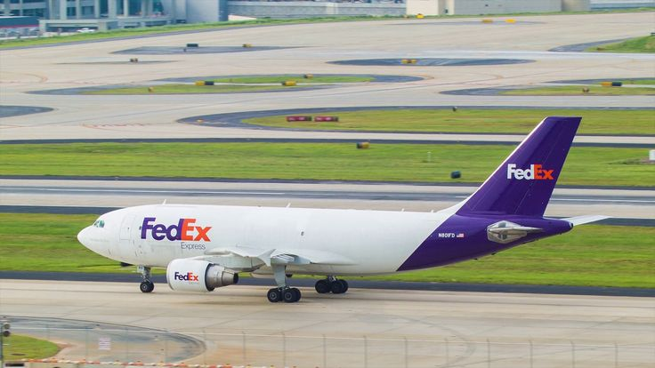 Fedex Airbus A310 Air Cargo Freighter Driving on a Taxiway at Atlanta International Airport Stock Video Footage - VideoBlocks
