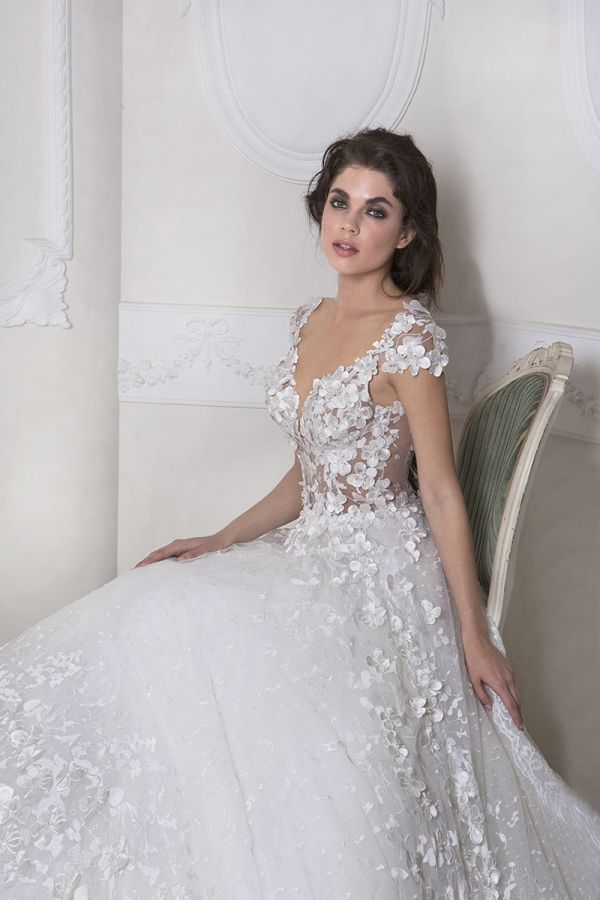 Ivory Princess line dress with a sweetheart neckline made with 3D Guipure lace