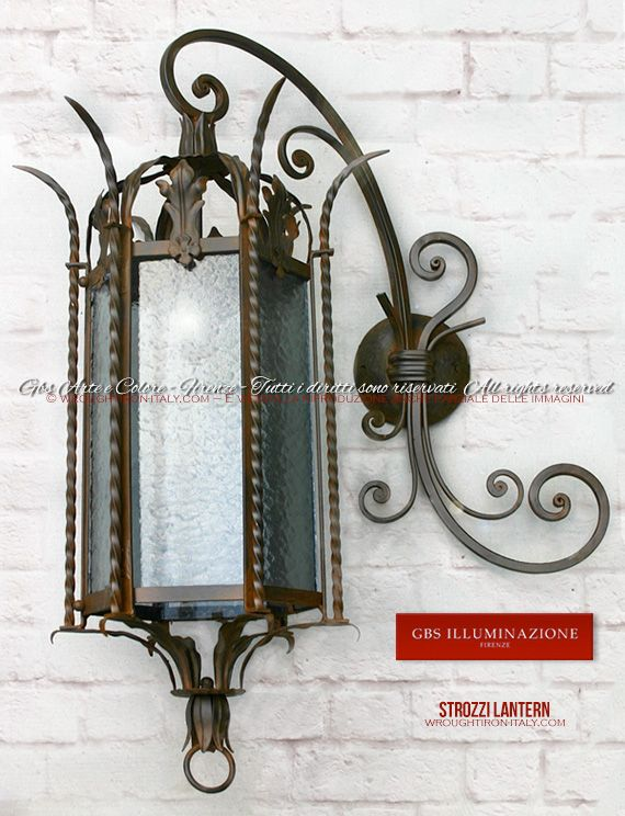 Wrought Iron Strozzi Lantern – Florence  Wall sconce version of the wrought iron Strozzi lantern with forged iron arm, cathedral glass, and a rust tempera finish.   For Indoor or outdoor use. GBS FIRENZE – MADE IN ITALY.