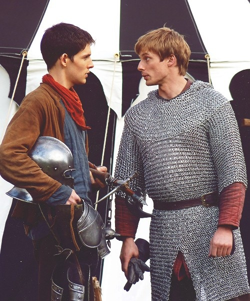 Merlin and Arthur, in their usual attitudes.