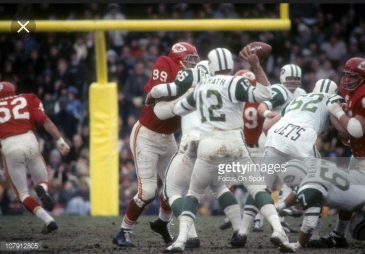 Ernie Ladd (99) Kansas City Chiefs rushing in on New York Jets QB Joe Namath (12)