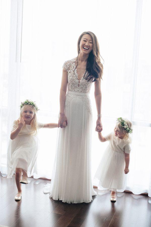Adorable bride + flower girl moment: http://www.stylemepretty.com/massachusetts-weddings/salem-ma/2016/01/06/backyard-seaside-massachusetts-wedding/ | Photography: Charlotte Jenks Lewis - http://charlottejenkslewis.com/