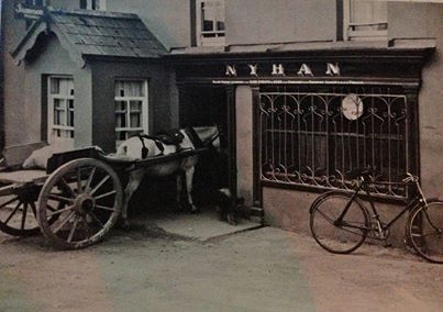 A HORSE WALKS INTO A BAR ...   The pub in this hazy photo is called Nyhan's.  The photographer was William Musgrave, sometime owner of the Metropole Hotel, Cork City, and is probably taken in the 1920s or 1930s.
