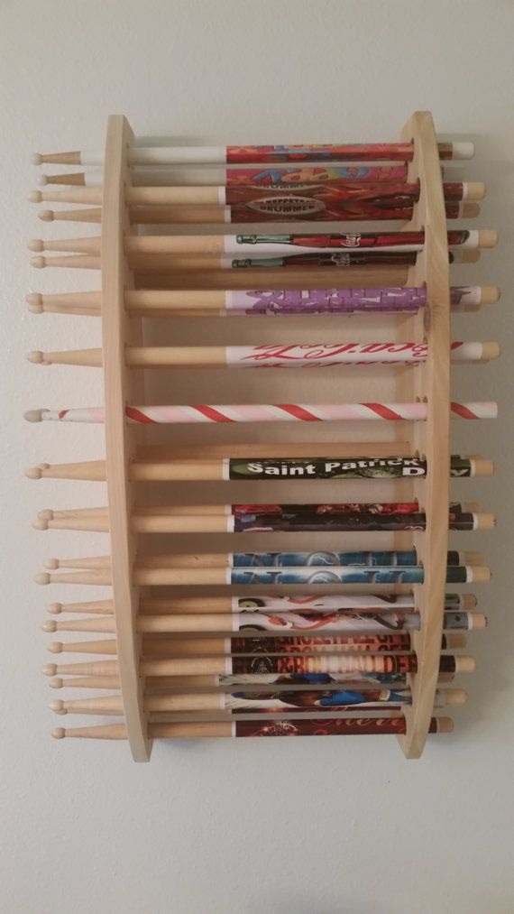 Custom made wooden drum stick display that is wall mounted as a vertical Display unit, giving a great visual look to your drum stick collection. Unit is all wood from expensive rough cut cedar and left unfinished to give it an absolutely awesome look and construction. and holds  13 pairs of sticks. Measures approximately 13 1/2 inches high, 24 1/2 inches wide  and 6 inches deep.   This is a must for any drummer and comes completely assembled, and ready to hang on the wall.  Let us build one…