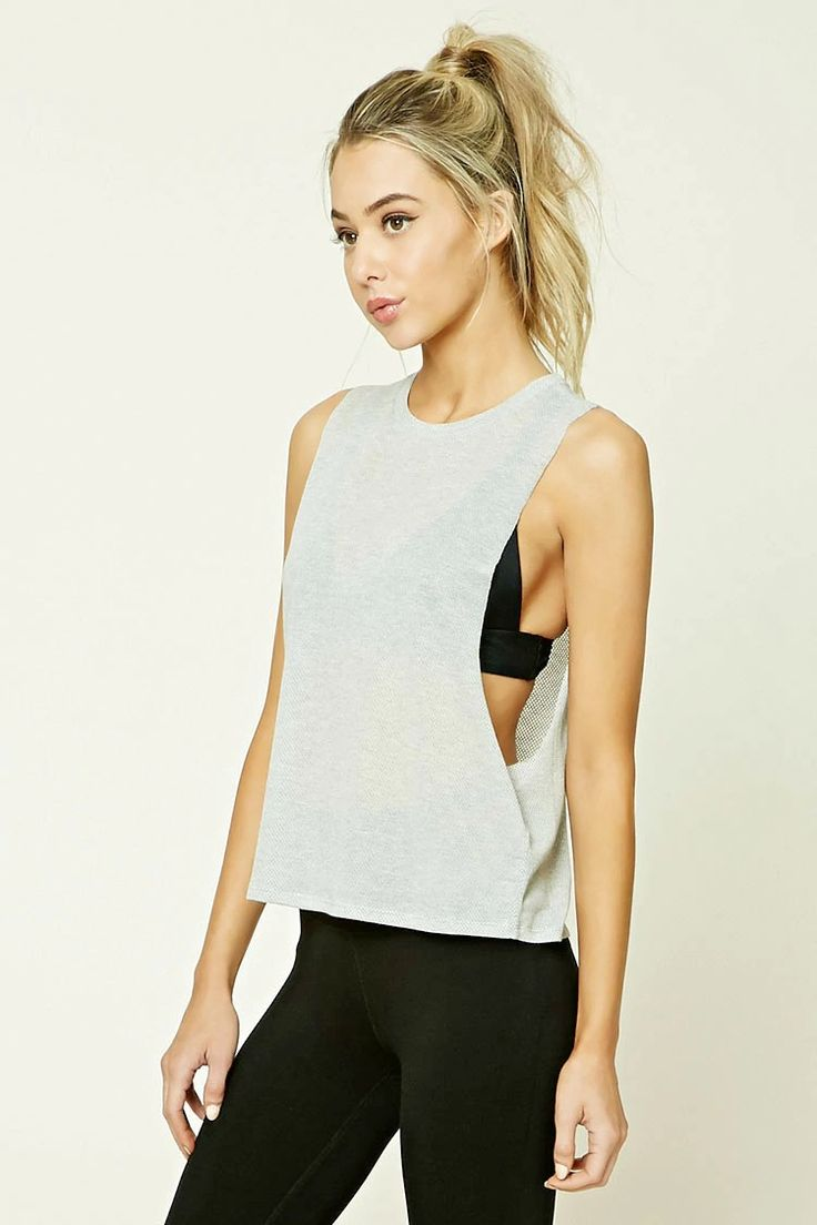 A textured knit athletic tank featuring a contrast panel on back, oversized raw-...