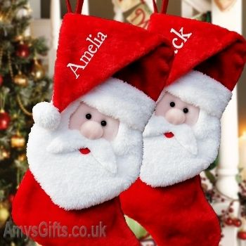 Personalised Stockings at Amysgifts.co.uk - Exclusive Santa in a hat stocking. A thick plush red stocking that is fully lined inside and designed by Amys Gifts with Santa Claus face and beard in plush white and the top has his Christmas hat hanging down in which a name is embroidered in white thread in a lovely Christmas font. Lovely quality Santa in hat Christmas Stocking with personalised name.