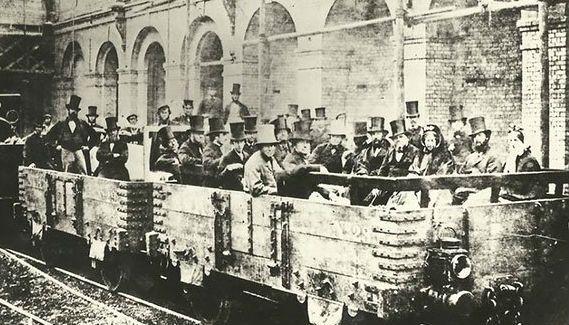 Before London underground trains took on the actual shape of a tube, they were merely wooden train carriages, as this 1862 photo of the first ever underground journey at Edgware Road Station shows.