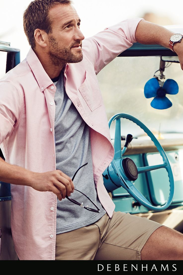 Men's Racing Green pink oxford shirt with beige chino shorts. Modelled by Ben Fogle.                                                      Perfect the summer smart casual trend by layering this Racing Green navy striped t-shirt with pink oxford shirt. Team it with a natural beige chino short for an understated tailored look. Available now at Debenhams.