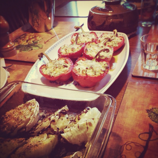 Amazing stuffed peppers. Halved and seeded red peppers stuffed with a mixture of ricotta, olive oil, fresh basil, garlic, rapini, tomato, and zucchini. Topped with fresh grated parmesan cheese. Cooked in the oven at 400 for 20 minutes. amazing. #stuffed #peppers #stuffedpeppers #ricotta #parmesan #cheese
