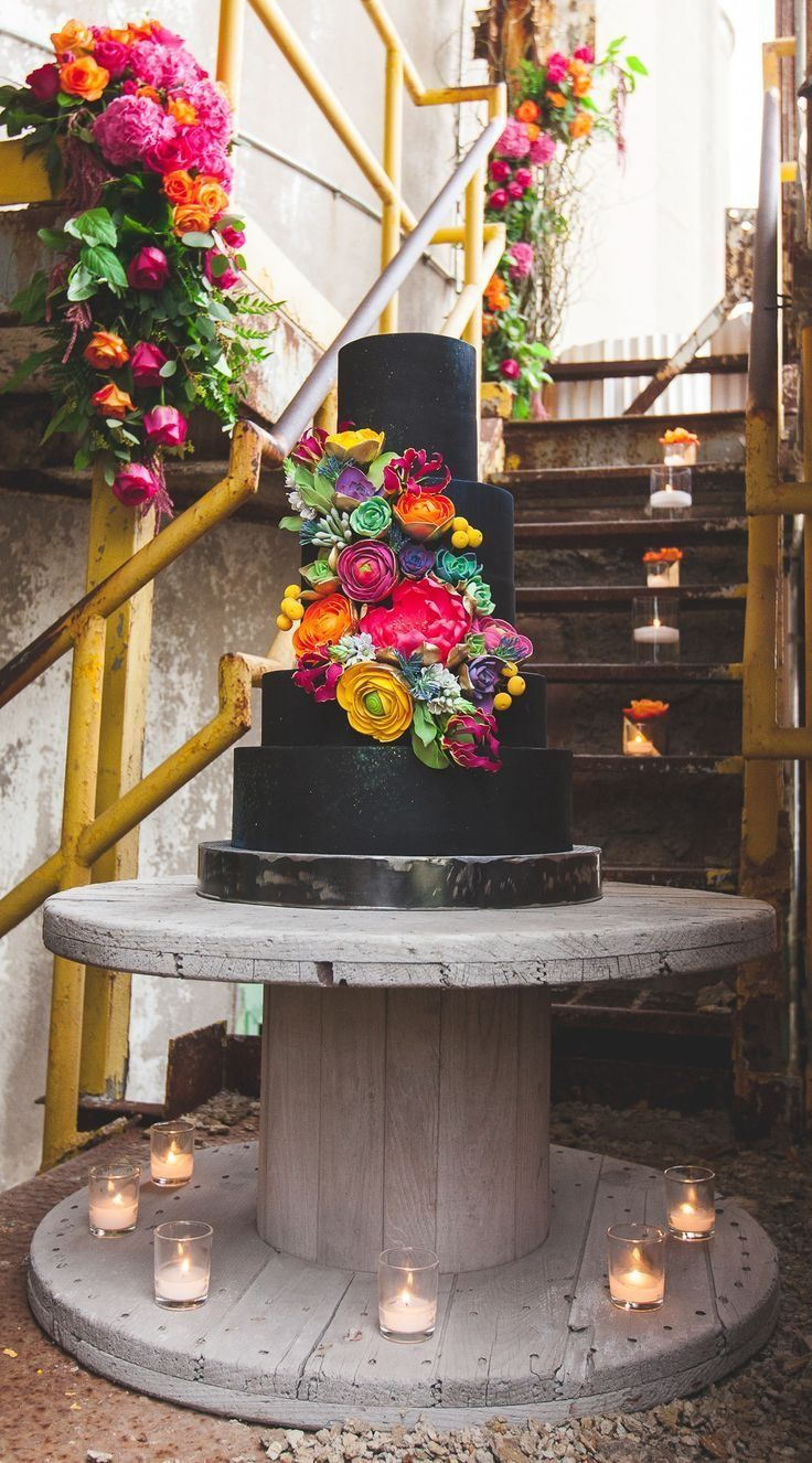 Wow ! Great bright and bold floral wedding cake with black icing🌿